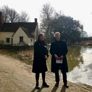 John Thornes and Sarah Milne standing in front of Willy Lott's House, Flatford.