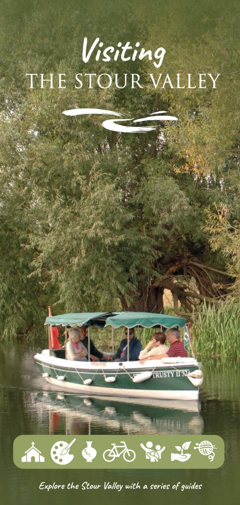 Photograph of an electric pleasure boat on the river by some trees
