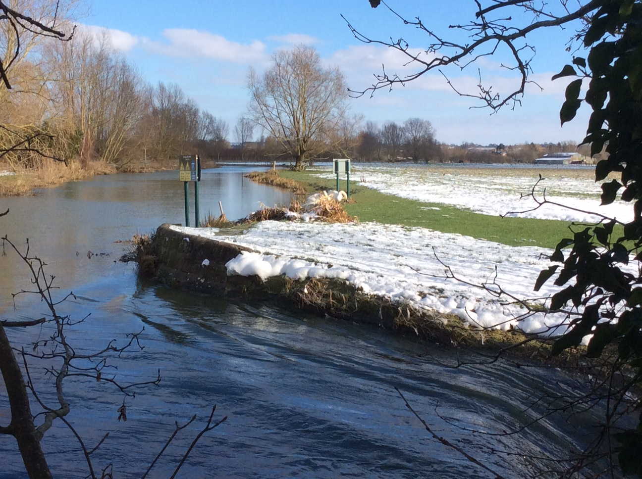 A bend in the River Stour in the snowy landscape
