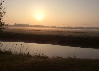 Sunrise over the water meadows on a frosty, April morning