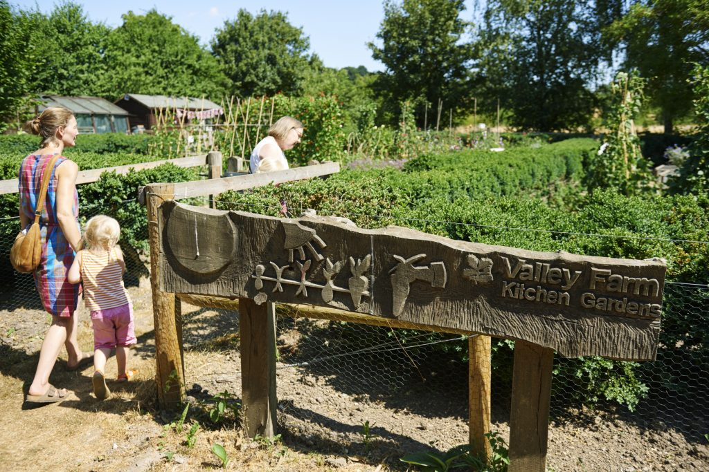 Visitors exploring Valley Farm Kitchen Garden at Flatford, Suffolk.