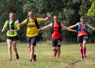 Four people running on the Stour Valley path