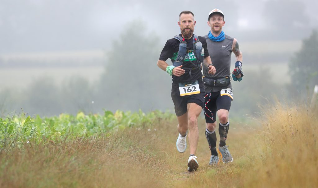 Two men running on the Stour Valley path