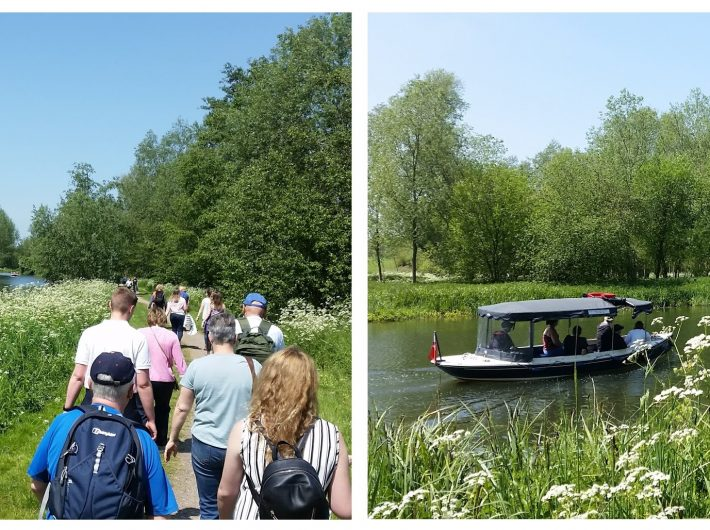 Image of walkers along side the River Stour and an electric boat on the river.