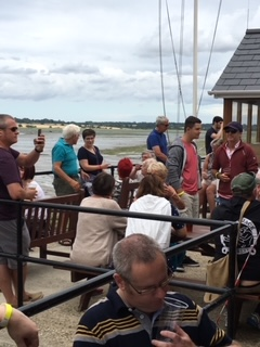 People drinking beer by the River Stour