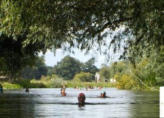 People swimming in the River Stour