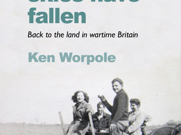 Book cover featuring wartime photograph of two men and two women standing on farm machinery